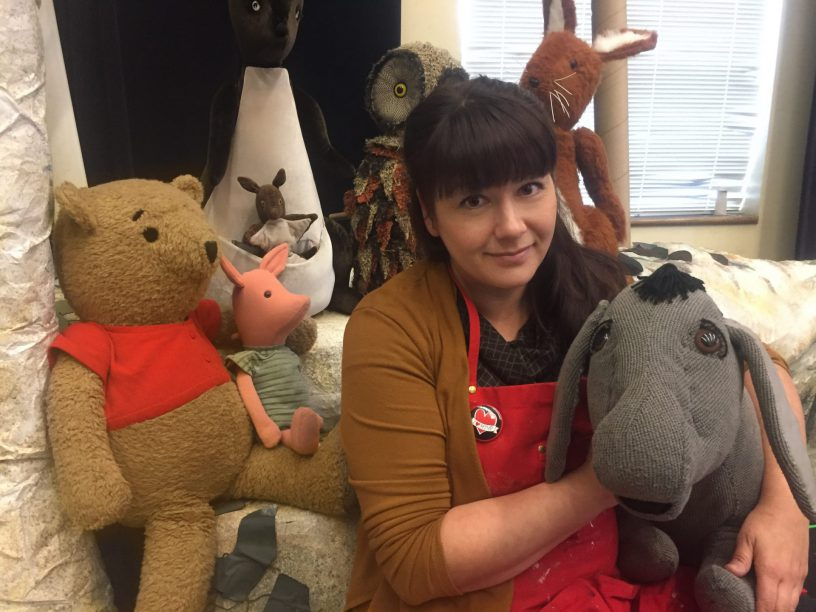 MTYP Head of Properties Janelle Regalbuto surrounded by puppets from The House at Pooh Corner