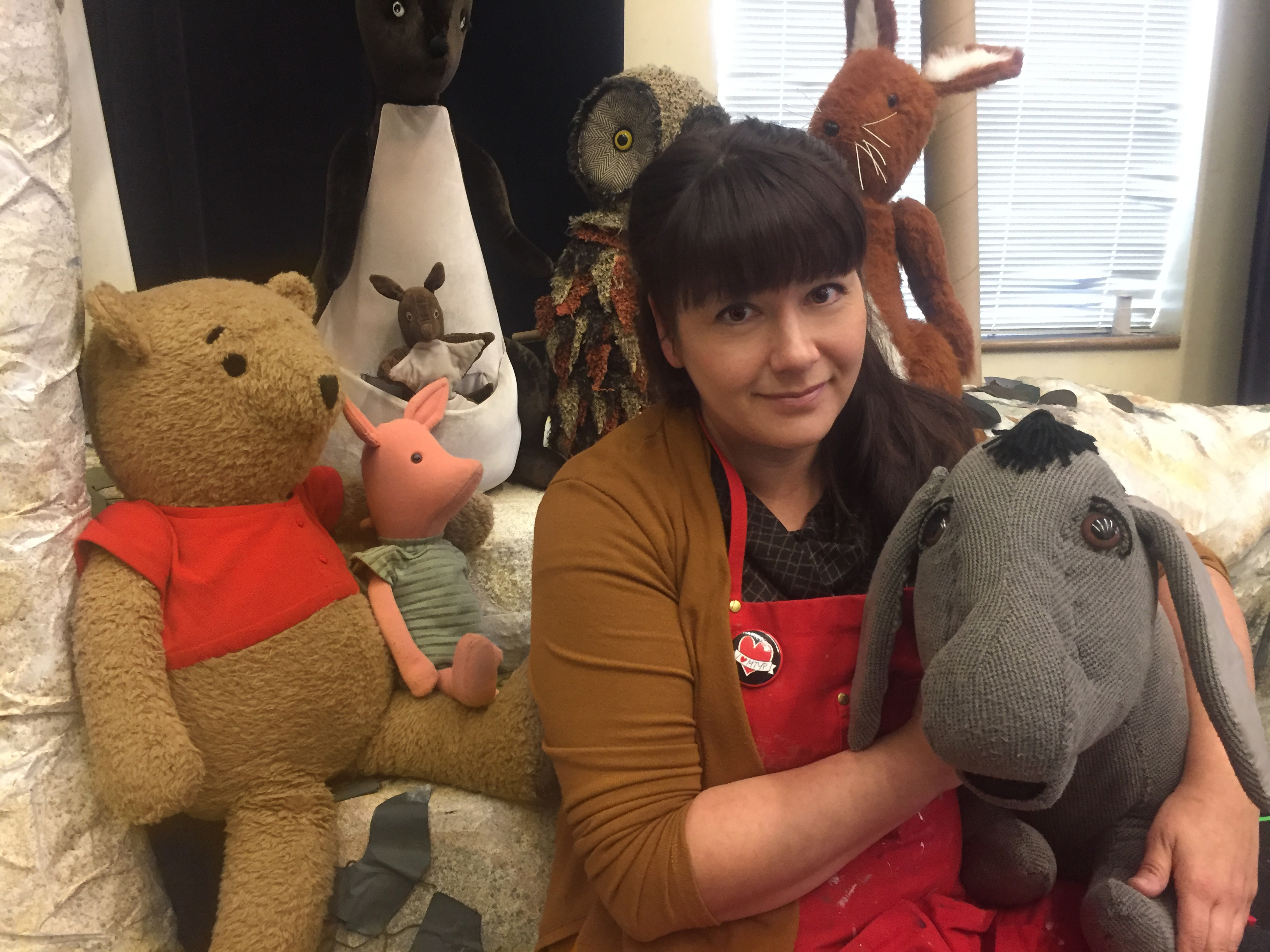 MTYP Head of Properties Janelle Regalbuto surrounded by puppets from The House at Pool Corner