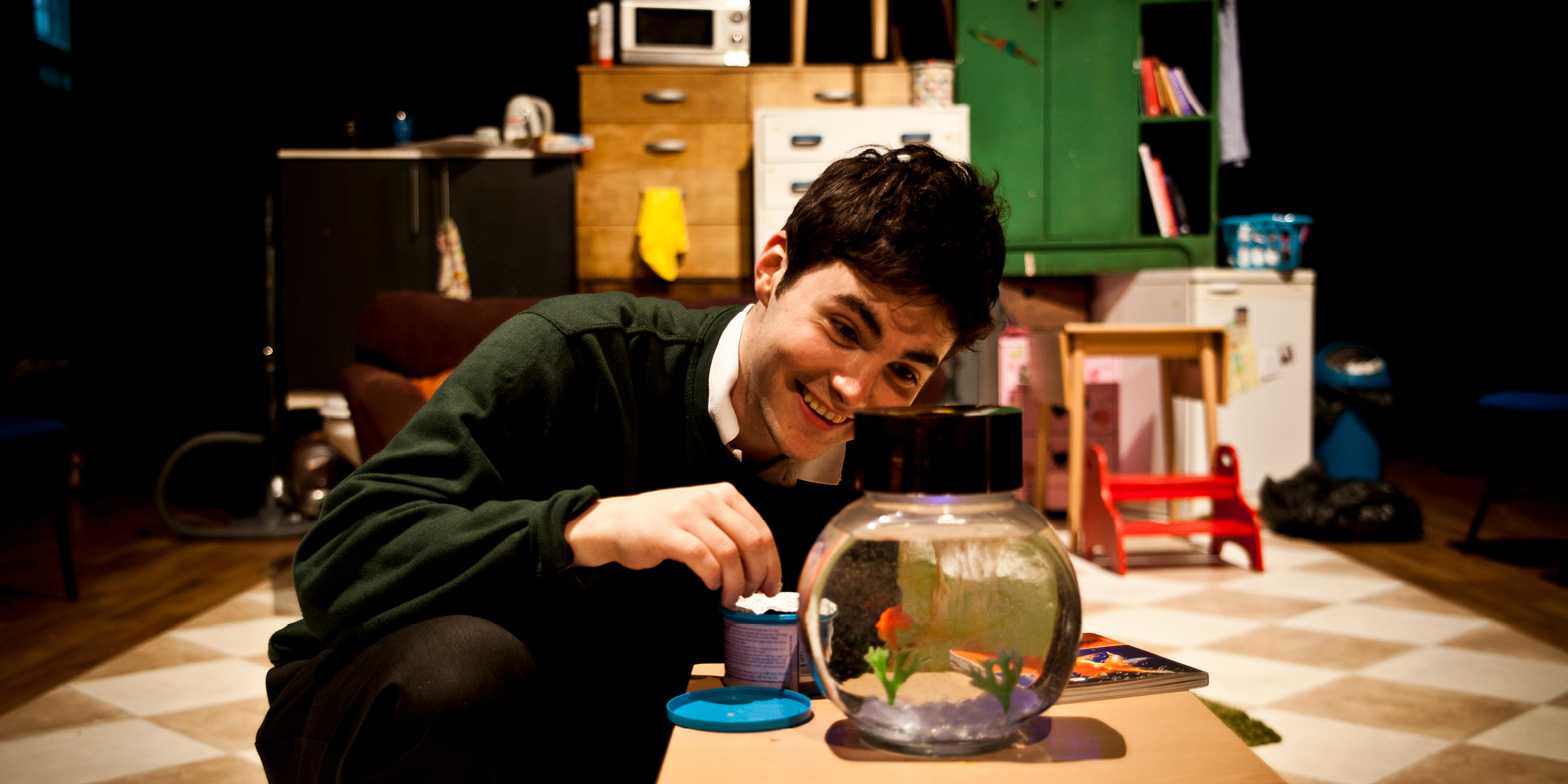 Adam Farrell with his goldfish in Tiny Treasures.