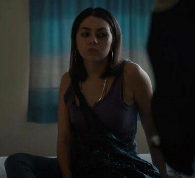 Actor Victoria Turko sitting on bed looking sad